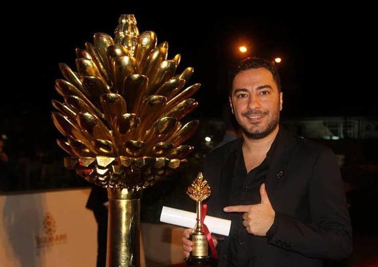 عکس نوید محمد زاده و جایزه بهترین بازیگر مرد سومین دوره جشنواره بینالمللی فیلم سلیمانیه